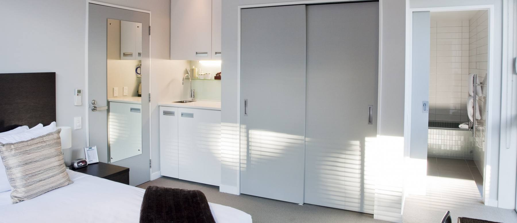About pounamu apartments with online reservations - Bank kitchenette ...